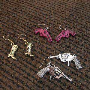 Guns and boot earrings.